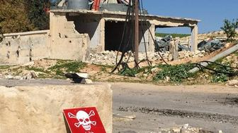 A poison hazard danger sign is seen in the town of Khan Shaykun Idlib province Syria on April 05 2017