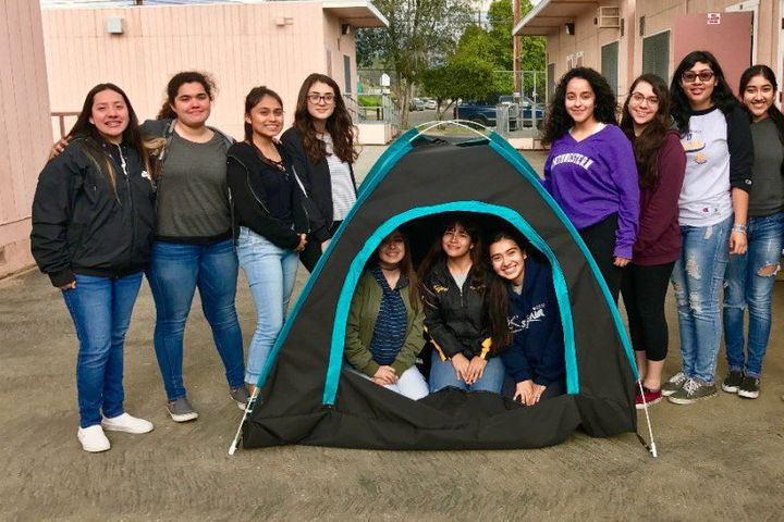 The girls of San Fernando High School with a prototype of their invention.