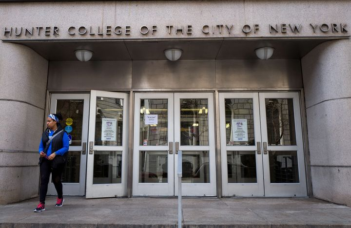 A student exits a building on the campus of Hunter College of The City University of New York on April 10.