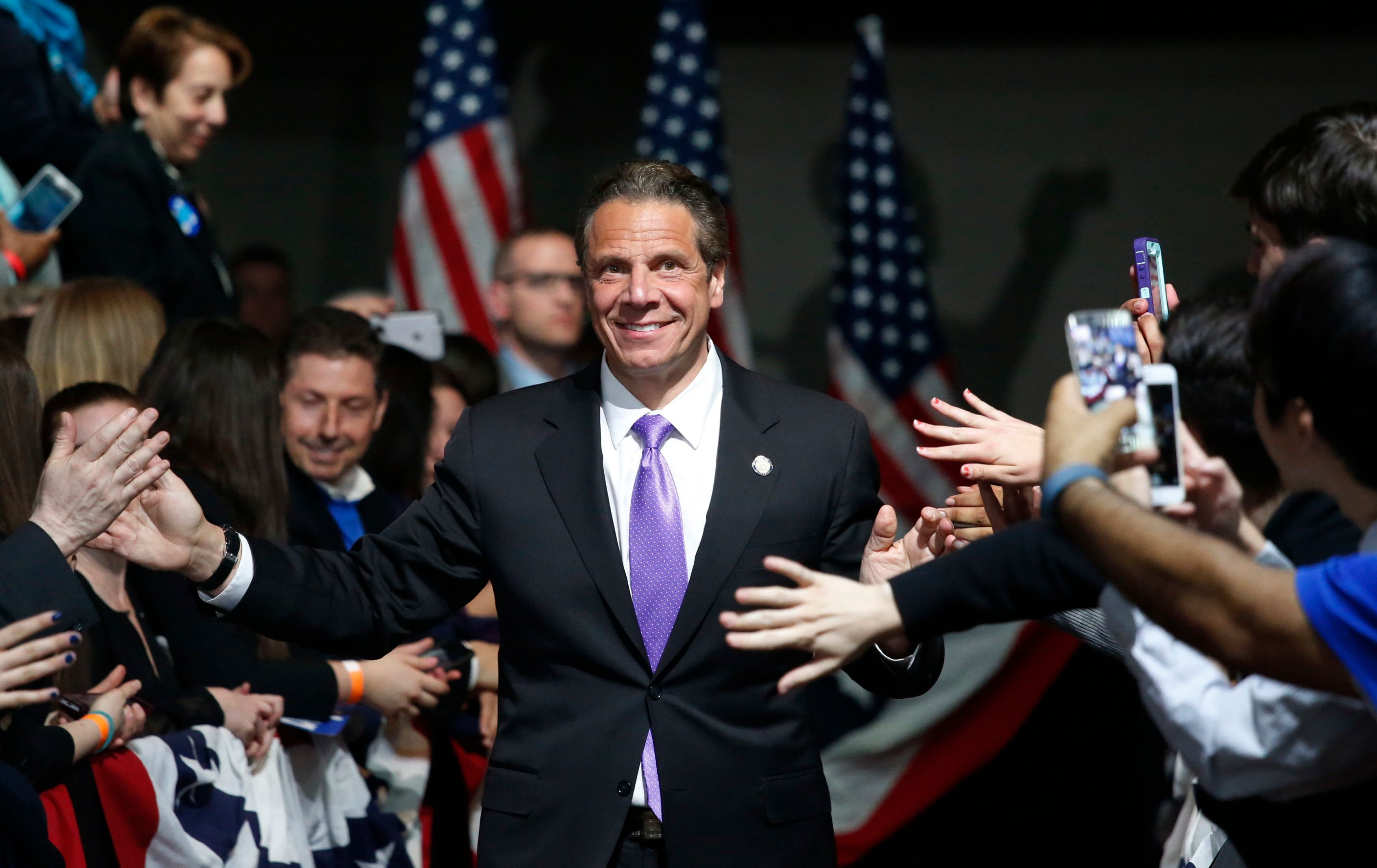 New York State Governor Andrew Cuomo enters the room before the arrival of Democratic U.S. presidential candidate Hillary Clinton at her New York presidential primary night rally in the Manhattan borough of New York City, U.S., April 19, 2016. REUTERS/Adrees Latif