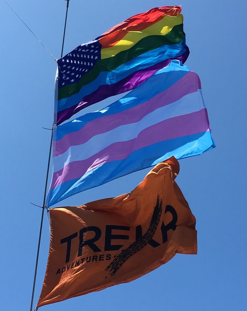 The gay pride flag, the Trans pride flag and the Trekr flag above the boat we raced in the 2017 BVI Spring Regatta.