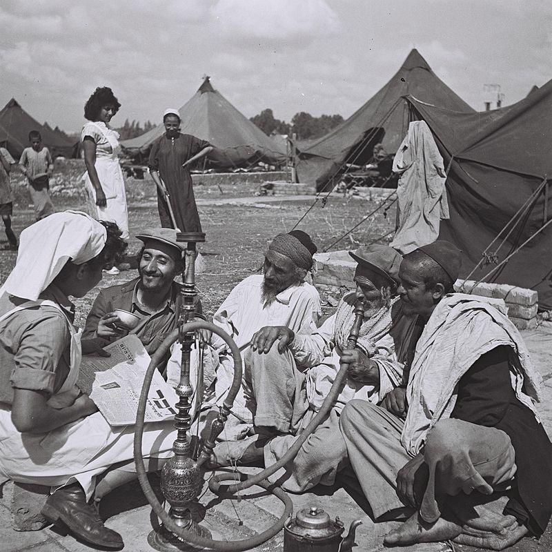 A young Yemenite nurse with Yemenite immigrants, Israel, 1949