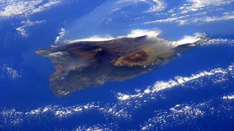 From the International Space Station European Space Agency astronaut Samantha Cristoforetti AstroSamantha took this photograph of the island of Hawaii and posted it to social media on Feb 28 2015 Cristoforetti wrote And suddenly as we flew over the Pacific the island of Hawaii with its volcanoes HelloEarth