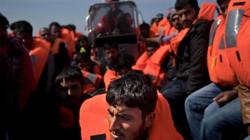 """Migrants are rescued from a rubber boat, 'dinghy,' by members of <a rel=""""nofollow"""" href=""""https://www.proactivaopenarms.org/"""""""