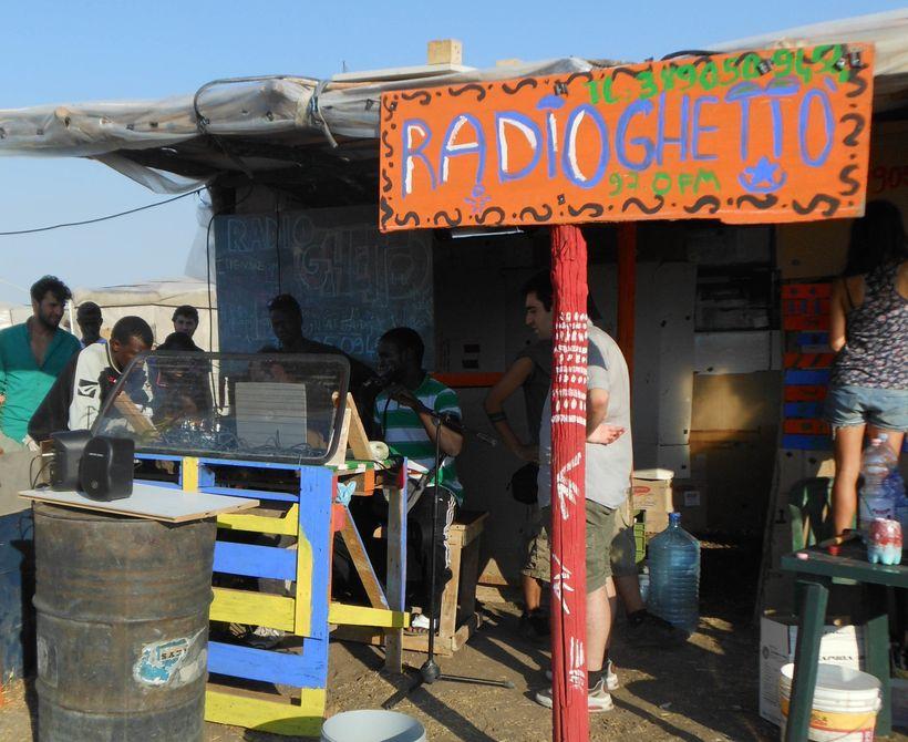 """Ghetto Radio, the radio subsidiary involving African laborers in Grand Ghetto Rignano Garganico in Puglia, 2014. (<a rel=""""nof"""