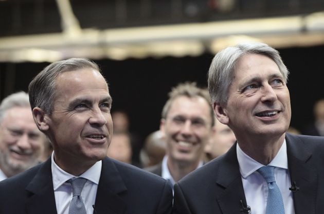 Philip Hammond and Mark Carney watched on asHinrikus delivered his