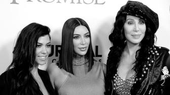 HOLLYWOOD, CA - APRIL 12:  (EDITORS NOTE: Image has been converted to black and white) (L-R) TV personalities Kourtney Kardashian, Kim Kardashian West and recording artist Cher attend premiere of Open Road Films' 'The Promise' at TCL Chinese Theatre on April 12, 2017 in Hollywood, California.  (Photo by Barry King/Getty Images)
