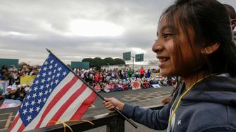 LOS ANGELES, CA JANUARY 15, 2016 -- Alexandra Rojas, a 5th. grader, holds a flag at a rally and 11th annual Stepping Out for Peace March held by students at 186th Street Elementary School to mark Martin Luther King Jr.'s birthday on Friday morning , January 15, 2016 in Los Angeles. (Photo by Irfan Khan/Los Angeles Times via Getty Images)