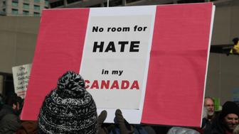 Pro-Muslim protestor carrying a sign saying 'No Room for Hate in My Canada' as opposing groups of protesters clashed over the M-103 motion to fight Islamophobia during pro-Muslim and anti-Muslim demonstrations in downtown Toronto; Ontario; Canada; on March 04; 2017. Canadians across the country staged similar protests against Islam; Muslims; Sharia Law and M-103. These protests were met by counter protests by those supporting Muslims and in favour of M-103. M-103 is a private members motion put forth by Liberal MP Iqra Khalid that asks the government to 'recognize the need to quell the increasing public climate of hate and fear' and condemn Islamophobia; as well as all other kinds of 'systemic racism and religious discrimination.' (Photo by Creative Touch Imaging Ltd./NurPhoto via Getty Images)