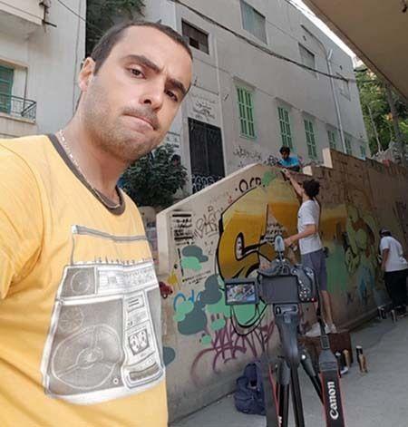 <em>Saab selfie with Beirut graffitti artists (courtesy Saab) </em>