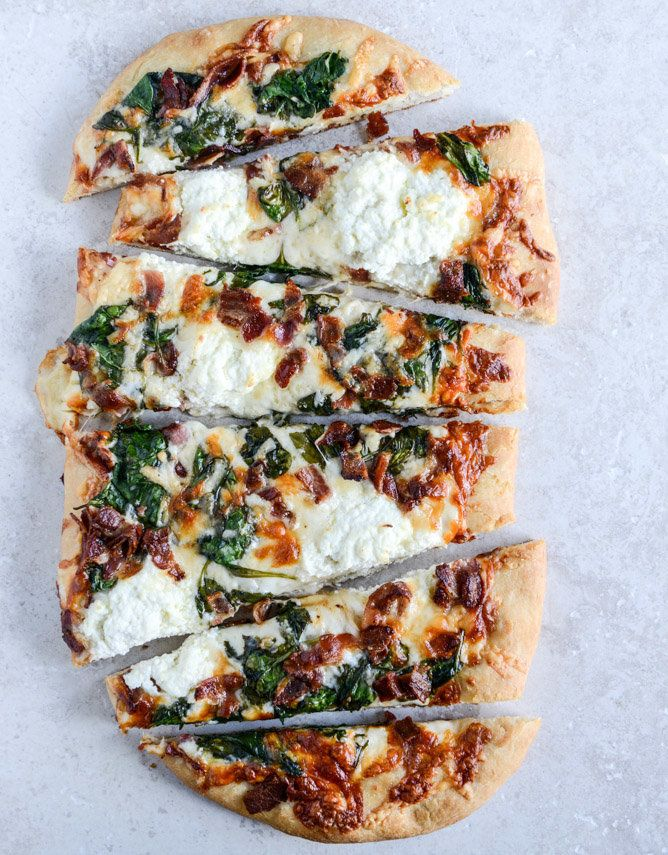 "<strong>Get the <a href=""http://www.howsweeteats.com/2014/01/white-pizza-with-spinach-and-bacon/"" target=""_blank"">White Pizza"