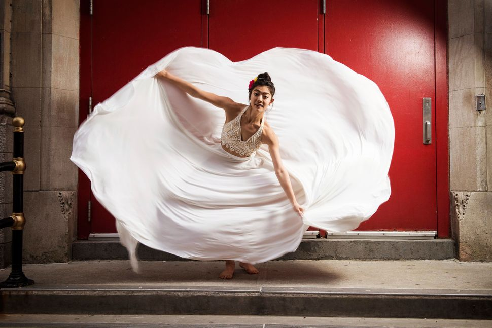 Shelby Colona, mid-twirl, near Ballet Hispánico's Upper West Side location.
