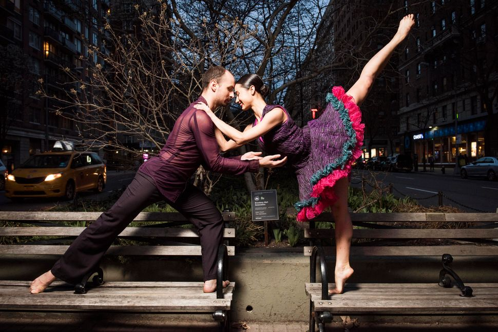 Dancers Joshua Winzeler, from Miami, Florida, and Eila Valls pose in the middle of Broadway in Manhattan.