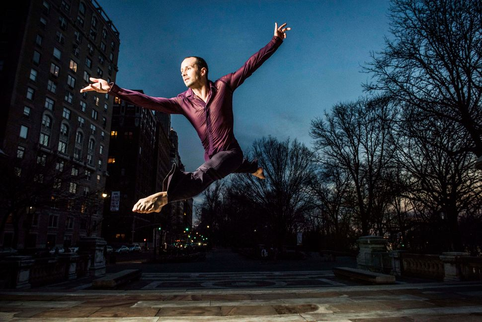 Joshua Winzeler jumps near Riverside Drive.