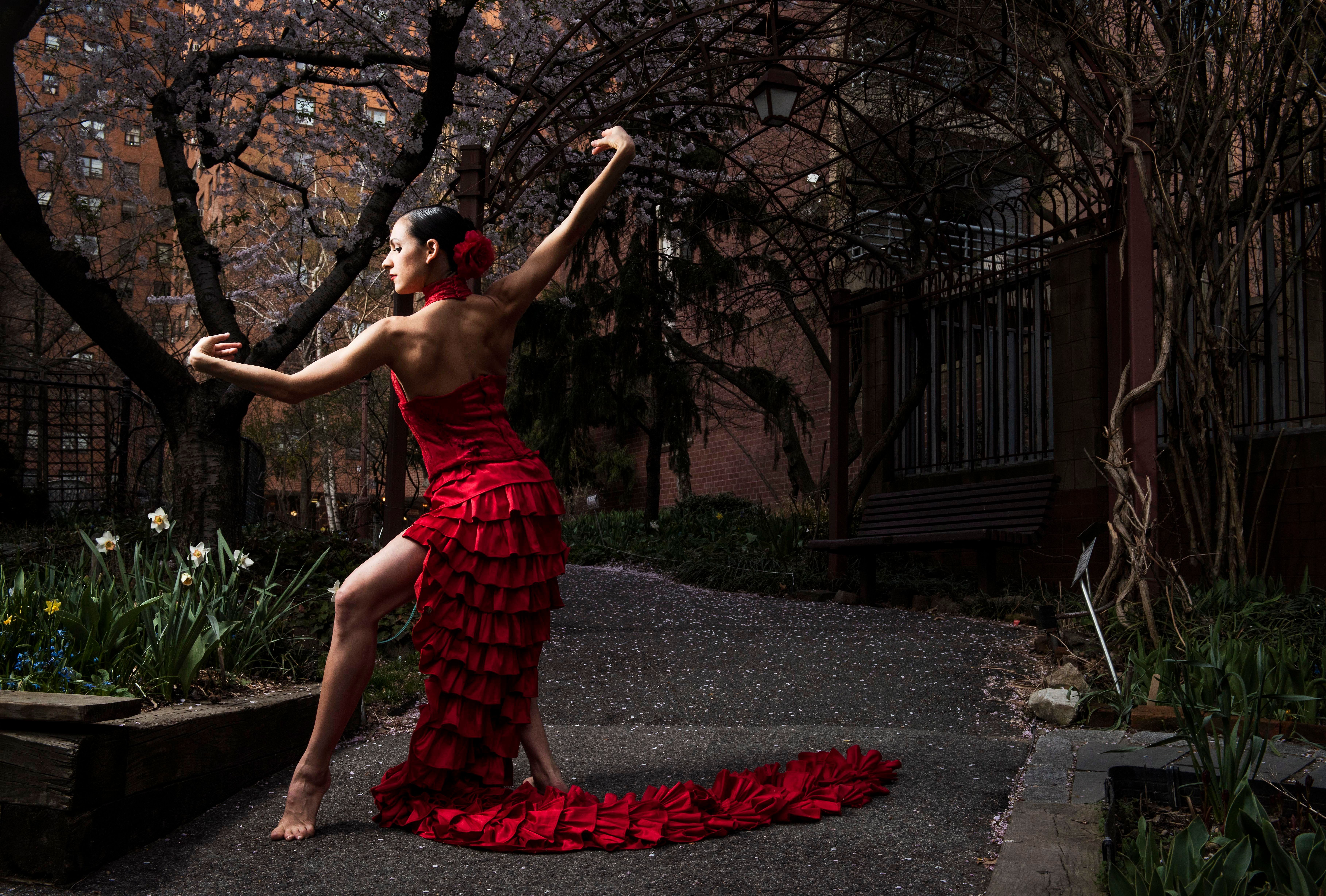 Ballet Hispánico dancer Melissa Fernandez, from Miami, Florida, poses in a community garden in Manhattan's Upper West