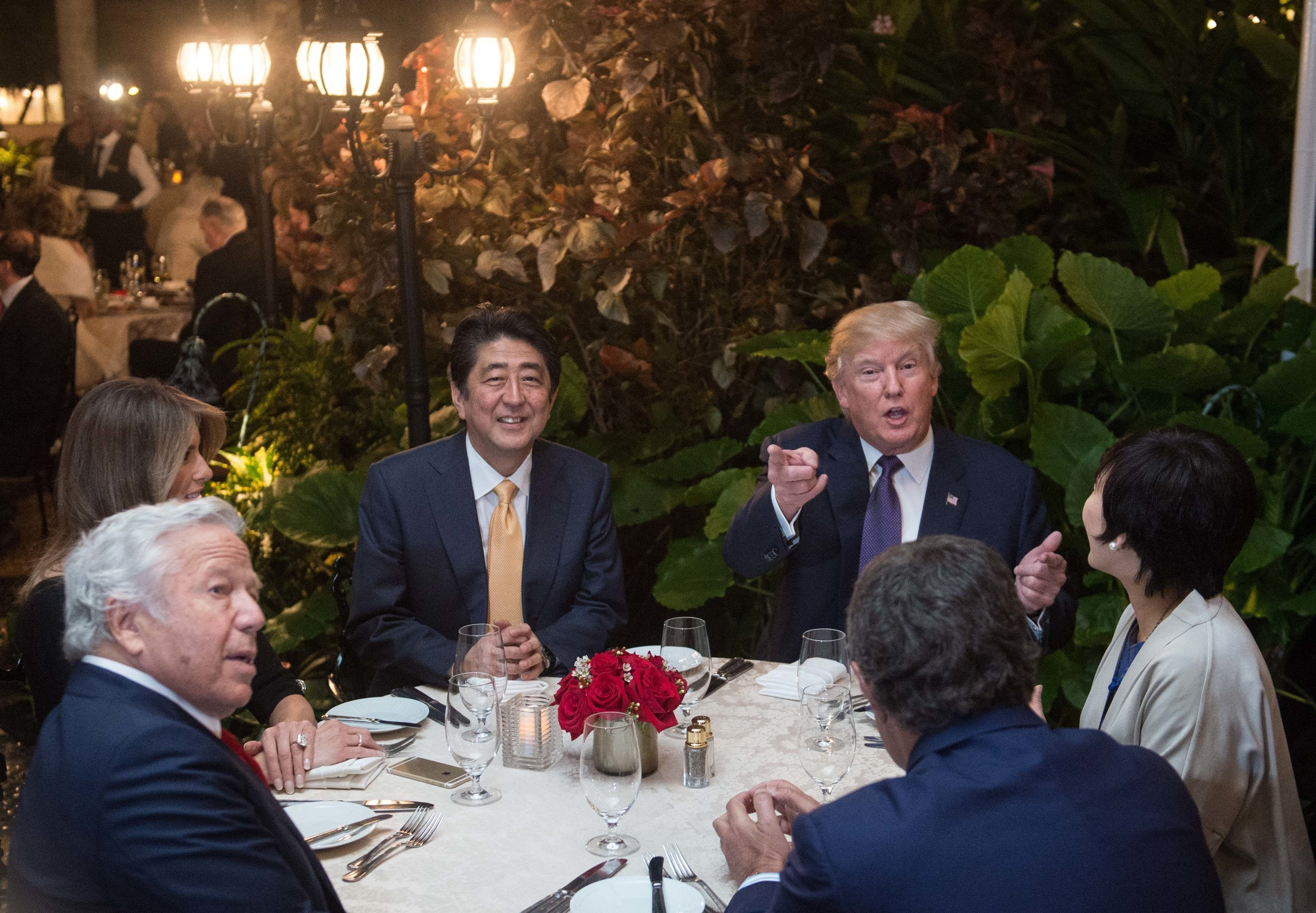 The Trumps,Japanese Prime Minister Shinzo Abe, his wife Akie Abe, and New England Patriots owner Robert Kraft haddinner at Mar-a-Lago in February.