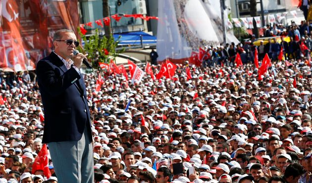 Turkish President Tayyip Erdogan addresses his supporters in Izmir, Turkey, during a rally for the upcoming...