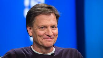 """Author Michael Lewis smiles during an interview at Reuters regarding his book about high-frequency trading (HFT) named """"Flash Boys: A Wall Street Revolt,"""" in New York April 3, 2014. REUTERS/Lucas Jackson (UNITED STATES - Tags: MEDIA BUSINESS)"""