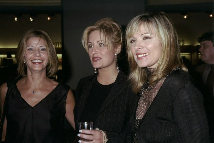 Kate Bohner (center) with Candice Bushnell and Kim Cattrall at a party years after the Lewis column.