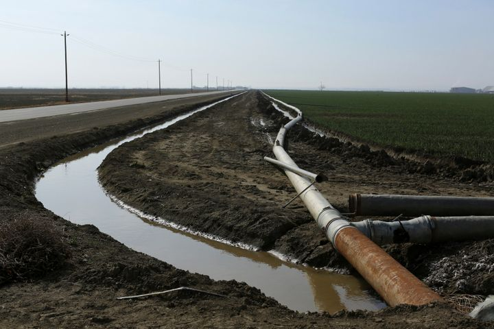 An irrigation pipe is seen at a farm near Cantua Creek, California. Communities in the San Joaquin Valley have been battling