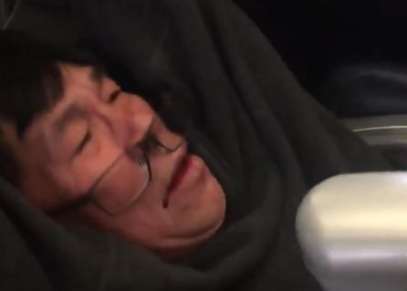 A still from a video of Dao being pulled from the flight showing his face bloodied in the now infamous