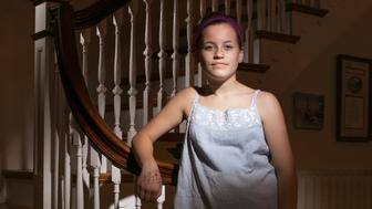 PORTLAND, ME - April 12: Molly Neuner poses for a photo in her Potland home after school on Wednesday, April 12, 2017. Her decision to wear the tank top was a deliberate protest against the dress code policy at King Middle School, where she goes to school. (Staff Photo by Gregory Rec/Portland Press Herald via Getty Images)