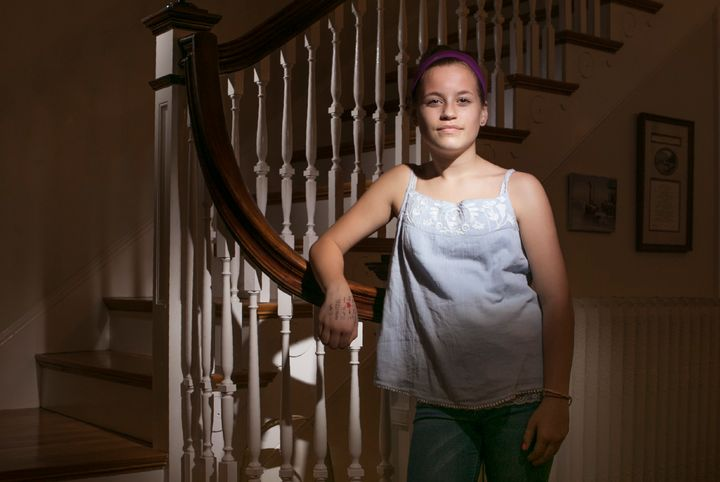 Molly Neuner poses for a photo in her Portland home after school on Wednesday, April 12, 2017. Her decision to wear the tank