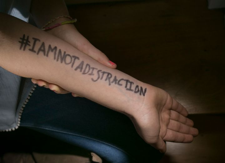 Sixth grader Molly Neuner wrote the hashtag #IAmNotADistraction on her arm as part of her protest against the dress code poli