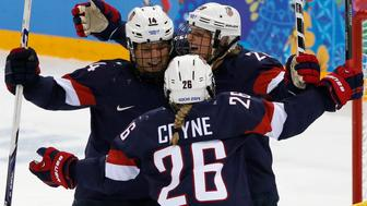 Team USA's Brianna Decker (14) celebrates her goal against Sweden with teammates Kendall Coyne and Amanda Kessel during the third period of their women's ice hockey semi-final game at the Sochi 2014 Winter Olympic Games February 17, 2014. REUTERS/Grigory Dukor (RUSSIA  - Tags: SPORT ICE HOCKEY OLYMPICS)