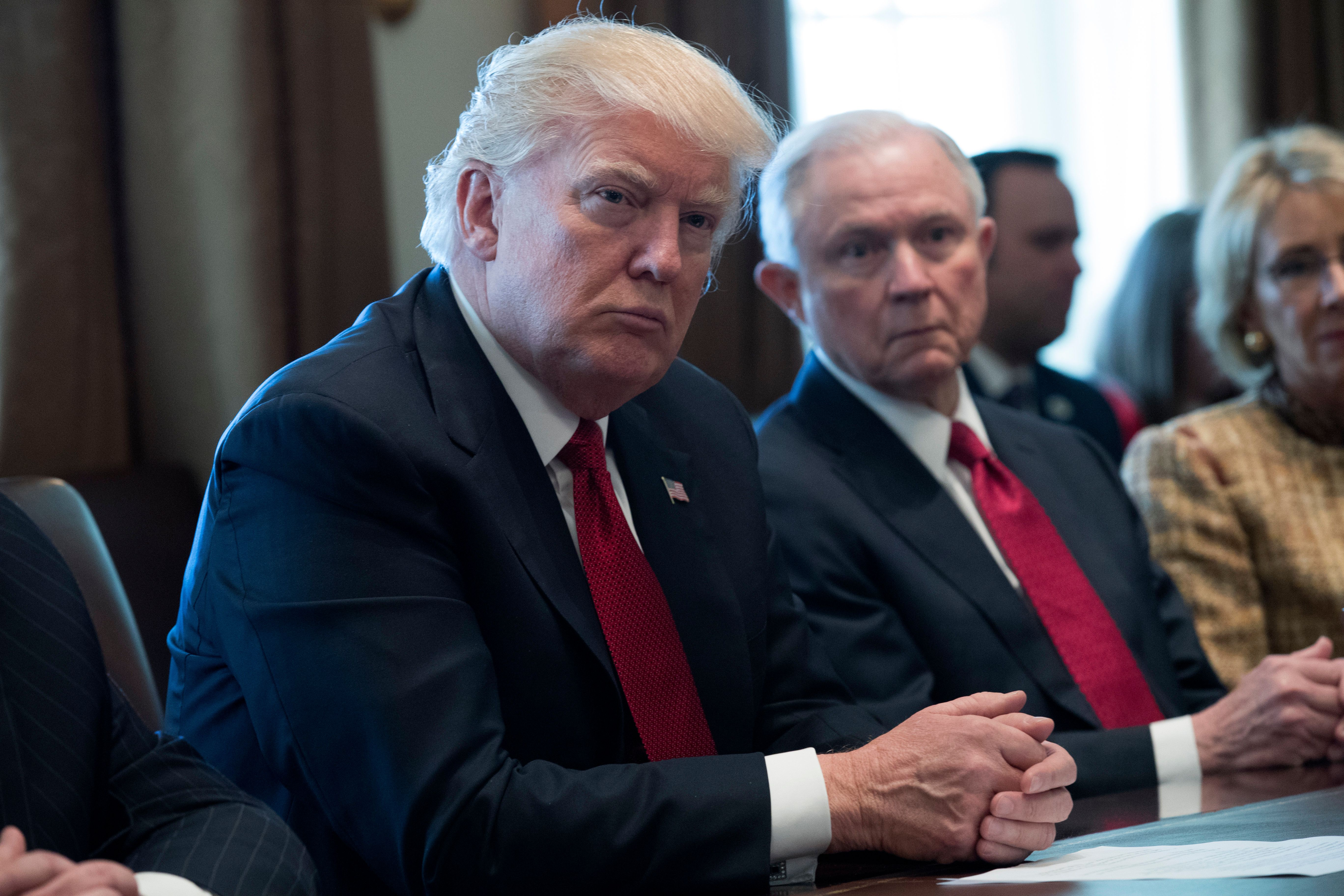 WASHINGTON, DC - MARCH 29:  U.S. President Donald Trump (L) and Attorney General Jeff Sessions (R) attend a panel discussion on an opioid and drug abuse in the Roosevelt Room of the White House March 29, 2017 in Washington, DC.  (Photo by Shawn Thew-Pool/Getty Images)