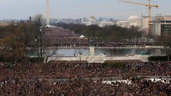 Crowds gather on the National Mall to witness the swearing-in ceremonies for President Barack Obama in front of the U.S Capitol in Washington, January 21, 2013.  REUTERS/Jim Bourg (UNITED STATES  - Tags: POLITICS)