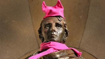 BOSTON, MA - JANUARY 21: Thousands of people filled Boston Common for the Boston Women's March for America, Saturday, Jan. 21, 2017. Someone adorned the statue of William Ellery Channing with a pink hat and scarf. The statue is on Arlington Street at the Boston Public Garden. (Photo by John Tlumacki/The Boston Globe via Getty Images)