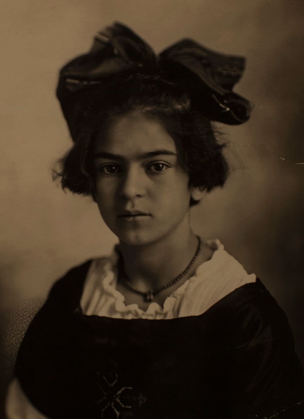 A portrait of Frida Kahlo by her father, Guillermo Kahlo, is displayed at the Frida Kahlo museum in Mexico City.