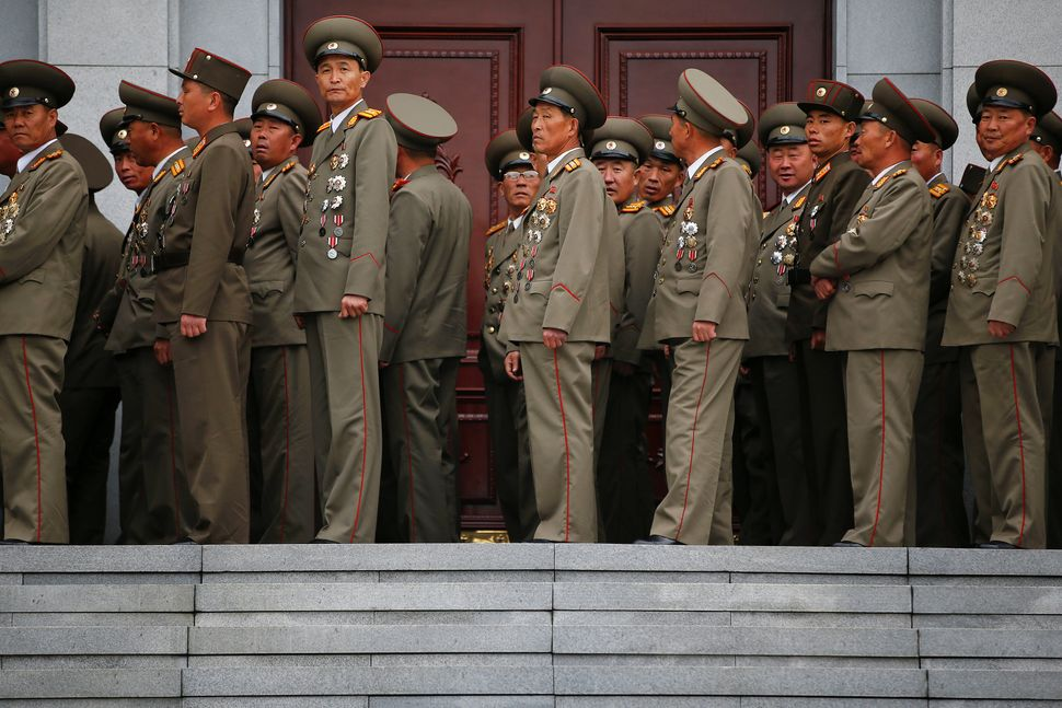 Military officers visit the birthplace of North Korean founder Kim Il Sung, a day before the 105th anniversary of his birth,