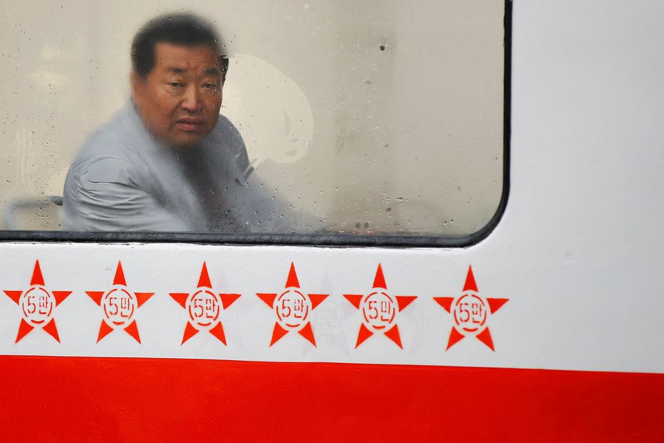 A man looks through the foggy window of a tram on a rainy day in central Pyongyang, April 14, 2017.