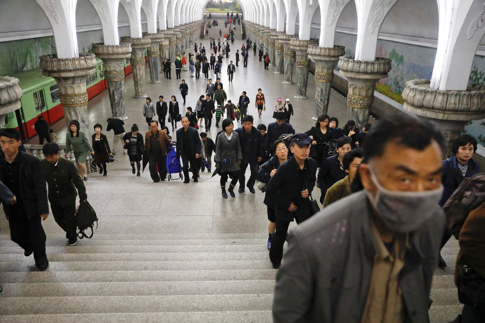 People leave a subway station visited by foreign reporters, in central Pyongyang, April 14, 2017.