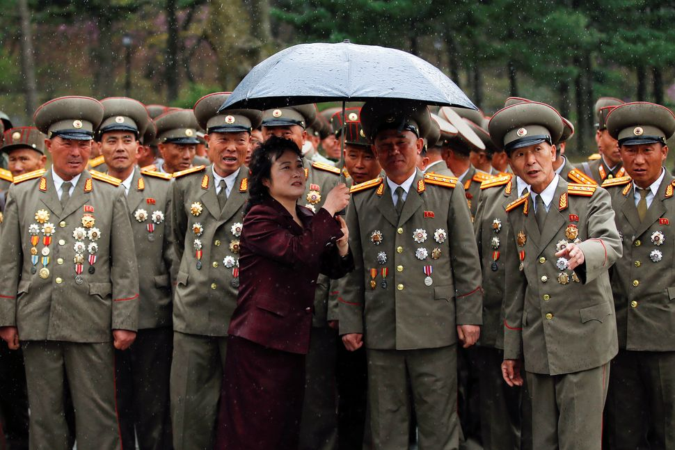 Rain falls as military officers visit the birthplace of North Korean founder Kim Il Sung, a day before the 105th anniversary