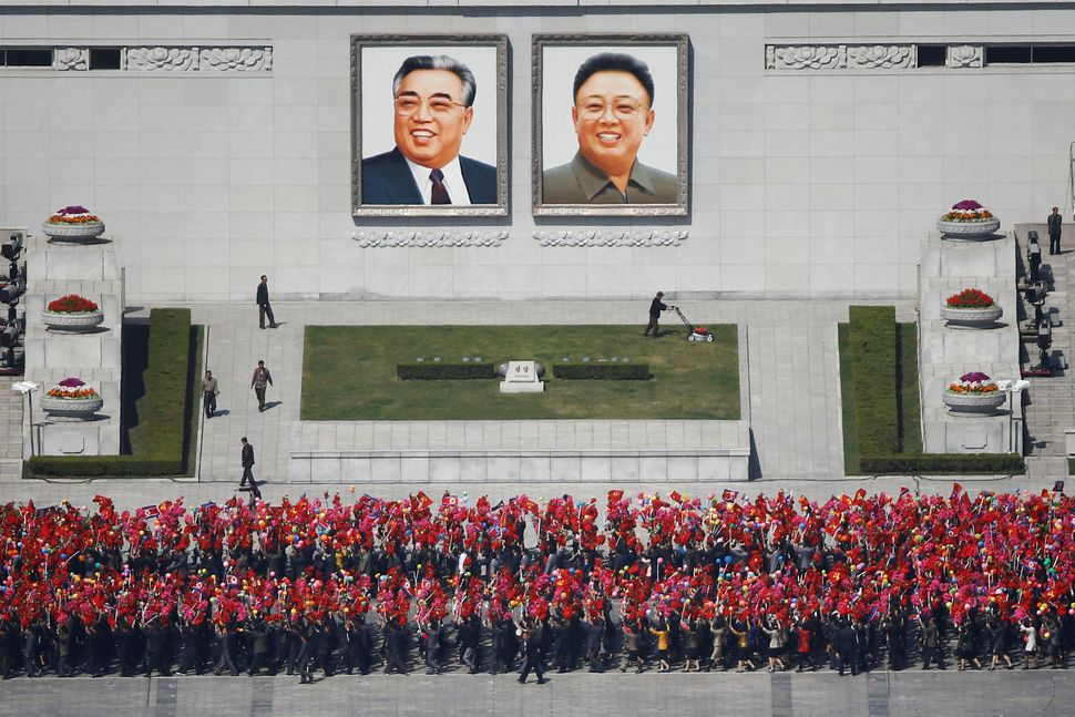 People practice for the parade on the main Kim Il Sung Square in central Pyongyang, April 12, 2017.