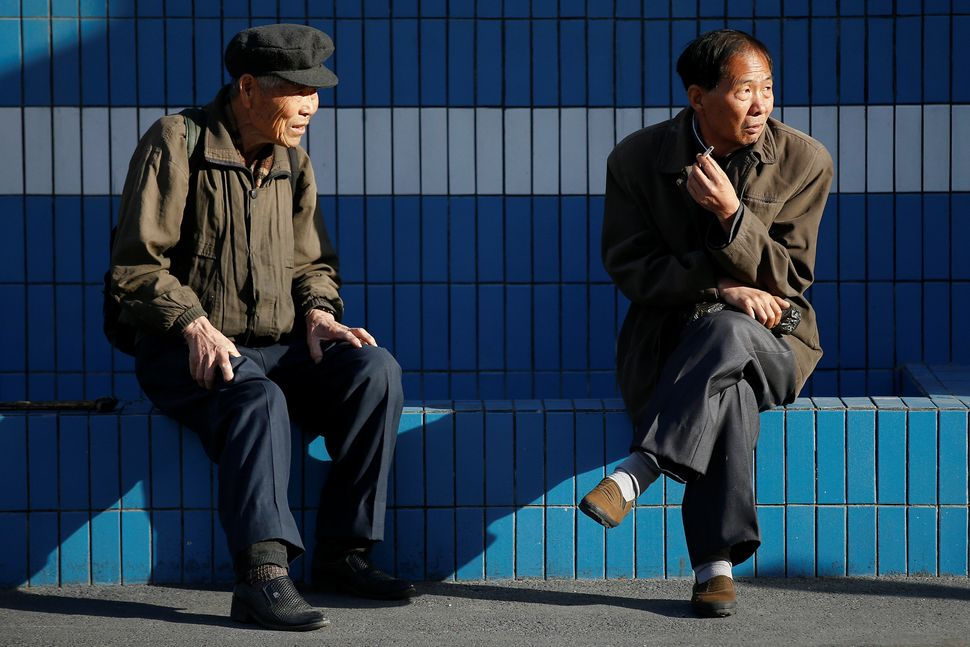 People chat in central Pyongyang, April 12, 2017.