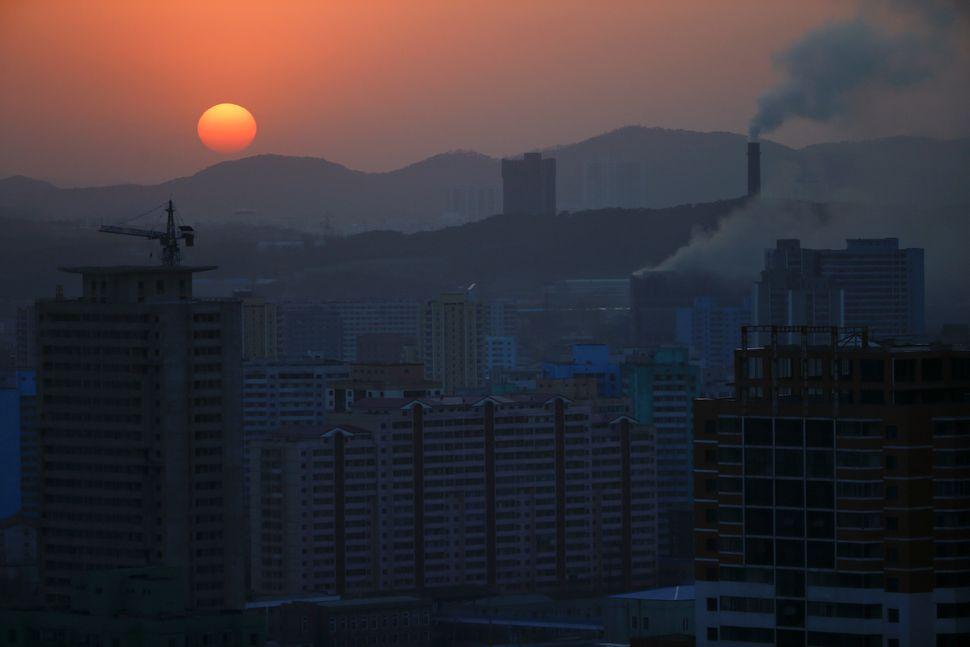 The sun sets in Pyongyang, April 12, 2017.