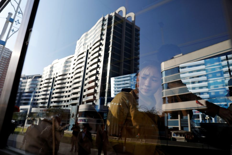 Passengers ride the bus in newly constructed area in central Pyongyang, April 12, 2017.