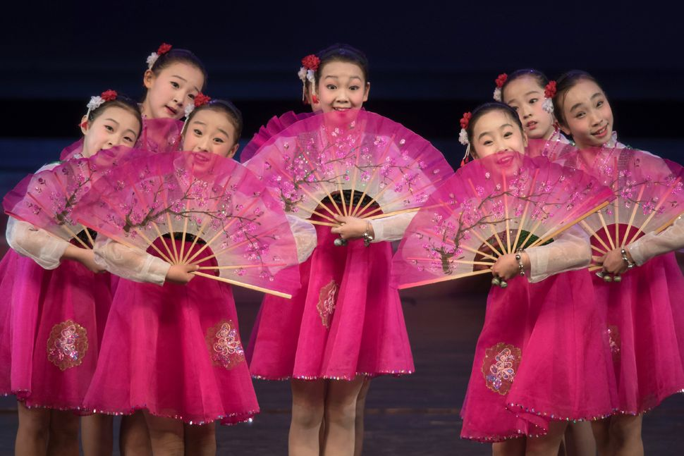 Children perform a dance and music show during an organized tour of the Childrens Cultural Palace for visiting foreign journa