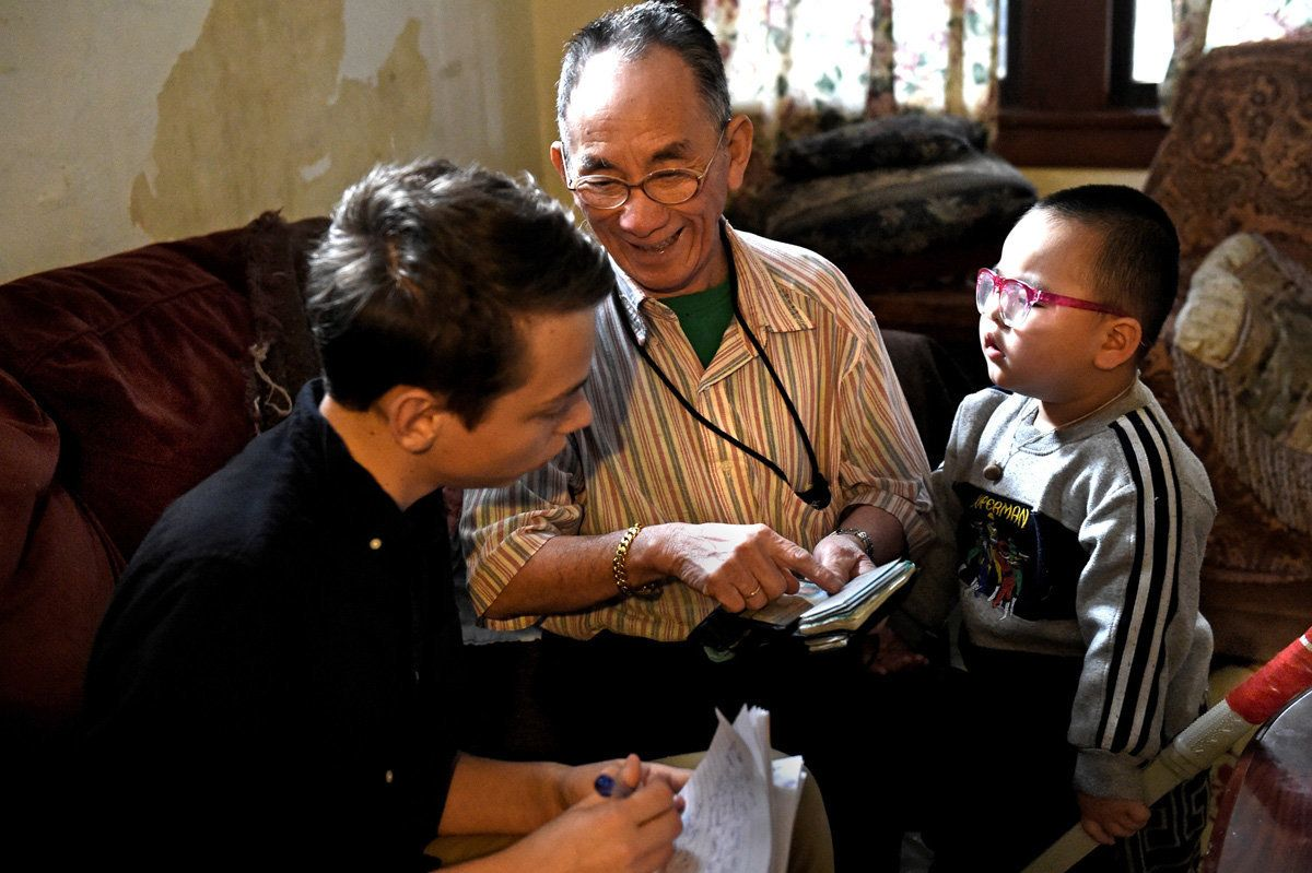 Ya Pao Lee, center, talks to student Henry Pellegrin about his experiences as a soldier in the Vietnam War as