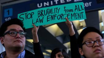 Demonstrators protest United Airlines at O'Hare International Airport on April 11, 2017 in Chicago, Illinois.  The protest was in response to airport police officers physically removing passenger Dr. David Dao from his seat and dragging him off the airplane, after he was requested to give up his seat for United Airline crew members on a flight from Chicago to Louisville, Kentucky Sunday night.  / AFP PHOTO / Joshua LOTT        (Photo credit should read JOSHUA LOTT/AFP/Getty Images)