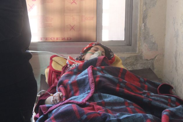 A wounded kid waits for the treatment after the chemical attack on April 4,