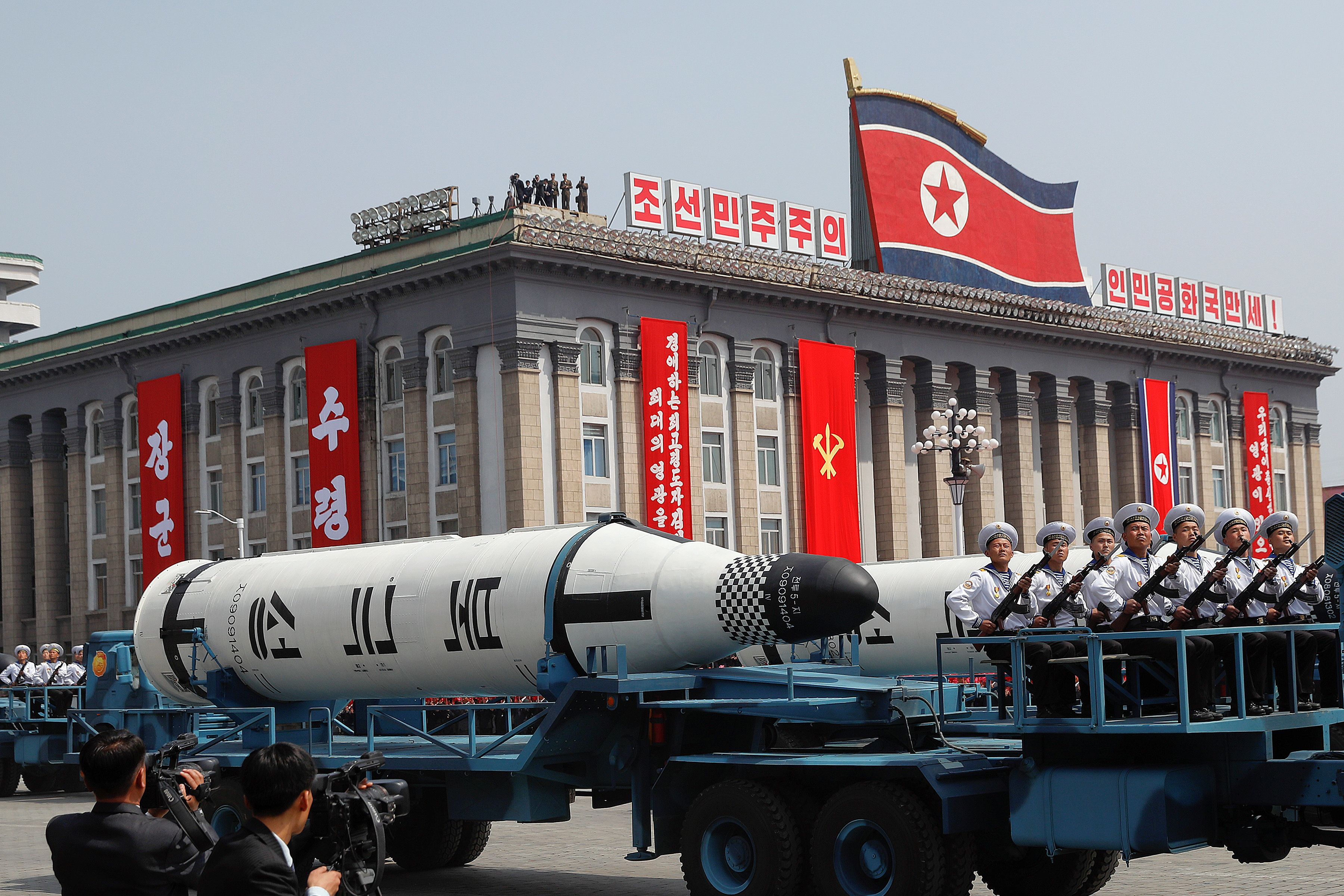Military vehicles carry missiles during a military parade in Pyongyang, North