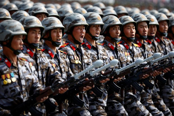 North Korean soldiers march and shout slogans during a military parade marking the 105th birth anniversary of country's found