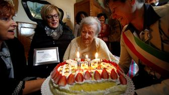 Emma Morano, thought to be the world's oldest person and the last to be born in the 1800s, reacts in front of her 117th birthday cake in Verbania, northern Italy November 29, 2016. REUTERS/Alessandro Garofalo
