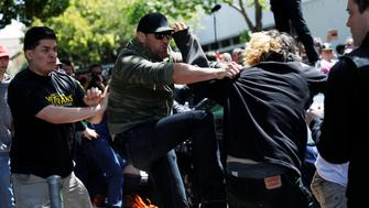 Demonstrators for and against U.S. President Donald Trump fight during rally in Berkeley, California in Berkeley, California, U.S., April 15, 2017. REUTERS/Stephen Lam