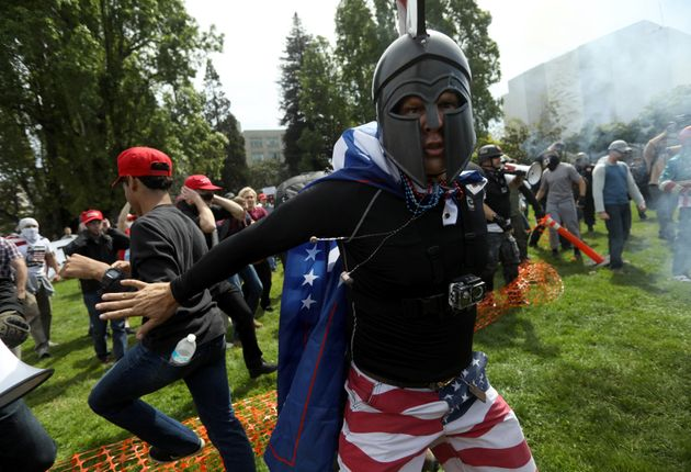 A pro-Trump protester breaks up a scuffle during the Patriots Day Free Speech Rally in Berkeley, California,...